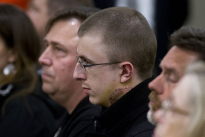 Micah Fletcher sits watching Jeremy Christian in court