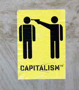stick figures of one person with a gun to another's head, labeled capitalism