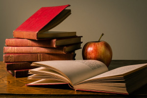 photo of red apple and books on desk