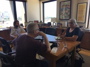 Multnomah County Chair Deborah Kafoury, Doug McVay (back to camera), and Central City Concern's Karen Kern.