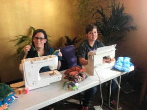 Positive Charge Members sewing therapeutic blankets
