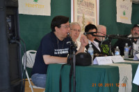 Sanho Tree (seated stage right) speaking on a panel at Seattle Hempfest