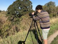 Ezra Cohen watching birds on the bluff above Oaks Bottom