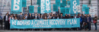 """photo of people with banners: """"we demand a climate plan"""""""